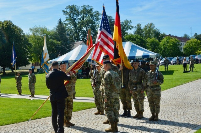Tommy R. Mize, director, Installation Management Command Europe, passes the IMCOM flag from USAG Stuttgart outgoing commander Col. Neal A. Corson to incoming commander Col. Jason W. Condrey, signifying Condrey's assumption of garrison command, July 10, 2019.