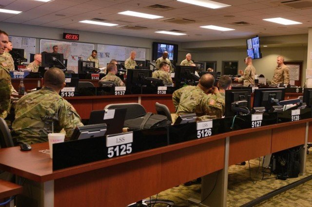Guardsmen receive their operational briefing on Tropical Storm Barry at the Louisiana National Guard Joint Operations Center, July 10, 2019, at Camp Beauregard, Pineville, La. In addition to high-water vehicles and boats staged in over 20 communities across the state in possible affected areas, the LANG has helicopters ready to support search and rescue, evacuation and recon missions as needed; as well as commodities distribution and security missions.
