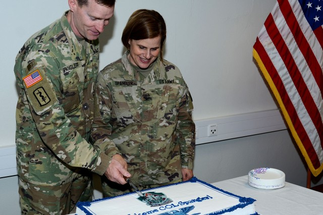 U.S. Army Col. Brian Spangler, incoming commander, Public Health Command Europe, and his wife, U.S. Army Col. Kathy Spangler, SHAPE Healthcare Facility commander, cut the cake following the change of command ceremony.