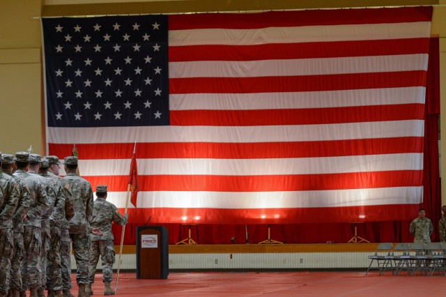 """Soldiers of 2nd Battalion, 18th Field Artillery, the """"Mission Ready Battalion,"""" stand in formation July 3, 2019, at their unit's colors casing ceremony at Rinehart Fitness Center here. The Multiple Launch Rocket System unit will deploy to the Republic of Korea for a nine-month rotation."""