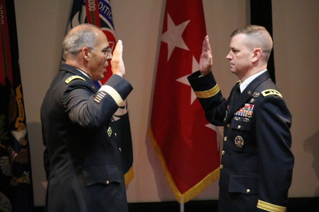 Army Materiel Command Commander, Gen. Gus Perna (left), administers the oath of office for AMCOM Commander, Maj. Gen. Todd Royar, following Royar's promotion to major general, July 11.  Royar assumed command of AMCOM in June.