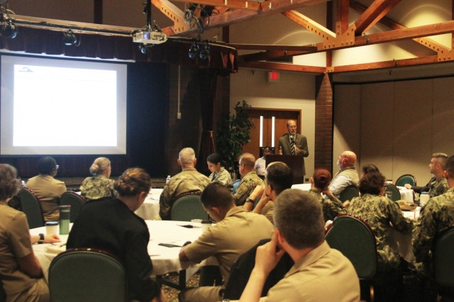 Ron Krogh, chief of staff, Puget Sound Military Health System, speaks to attendees during the recent Puget Sound MHS Quadruple Aim Performance Plan Executive Session at Joint Base Lewis-McChord, Washington.