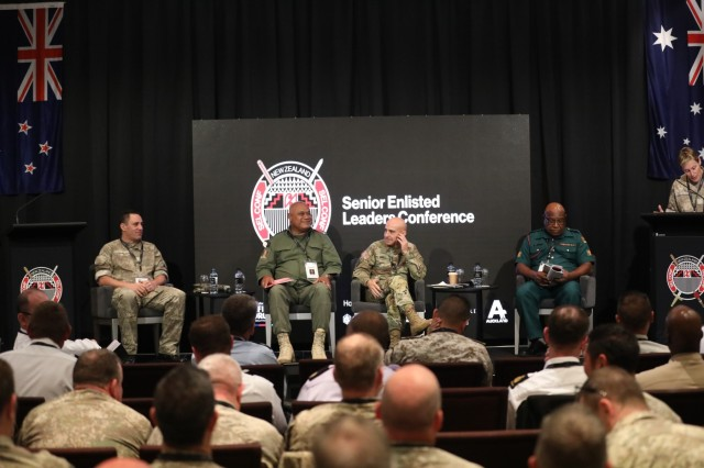 From left to right, New Zealand Sgt. Maj. of the Army Warrant Officer Class 1 Clive Douglas; Republic of Fiji Military Force Warrant Officer Class 1 Waisake Ratu, force sergeant major; Command Sgt. Maj. Benjamin Jones, U.S. Army Pacific senior enlisted advisor; and Papua New Guinea Defence Force Warrant Officer Class 1 Joseph Kamane, force sergeant major; sit on a panel July 8 in Auckland, New Zealand. These senior enlisted leaders attended the first New Zealand Army Senior Enlisted Leader's conference that occurs biennially.