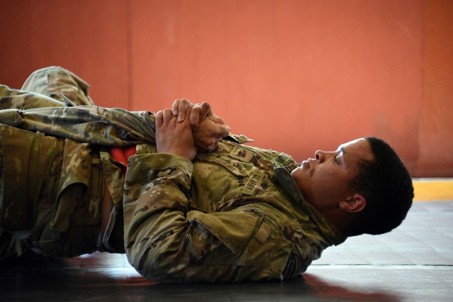 Sgt. Chayse Burns, Headquarters and Headquarters Company, 53rd Signal Battalion, 1st Space Brigade, Fort Carson, Colorado, performs a move during the combatives portion of the U. S. Army Space and Missile Defense Command/Army Forces Strategic Command's 2019 Best Warrior Competition July 10 at Fort Carson. Burns was named the SMDC Noncommissioned Officer Best Warrior for 2019. (U.S. Army photo by Carrie David Campbell)