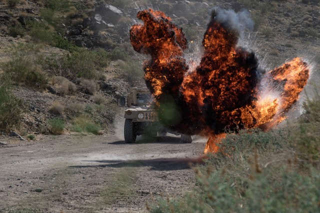 Reserve Soldiers from 451st Civil Affairs Battalion are exposed to live explosives while on a convoy during a react-to-fire training exercise at the National Training Center at Fort Irwin, Calif., June 10, 2019. The 451st is supporting the 116th Cavalry Brigade Combat Team at a month-long NTC rotation that provides more than 4,000 service members from 31 states, including units from 13 National Guard states and territories, with realistic training to enhance their combat, support and sustainment capabilities.