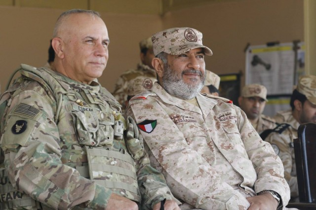 Task Force Spartan Commander, Maj. Gen. Ben Corell, and Maj. Gen. Khaled Saleh Al-Sabah, commander of the Kuwait Land Force, observe a joint live-fire exercise with Task Force Spartan and Kuwait Soldiers at Udari Range Complex in Kuwait on Dec. 12, 2018.Desert Observer, a biannual event conducted as part of Task Force Spartan, is an exercise that integrates a three-stage planning process, a dry run-through and a joint live-fire exercise geared toward increasing interoperability and cohesiveness between the United States Military and Kuwaiti Land Forces.