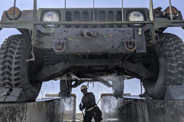 U.S. Soldiers of the 34th Red Bull Infantry Division conduct wash-rack operations at Camp Arifjan, Kuwait, June 13, 2019. Wash-rack operations begin with cleaning, preparing for and executing of a U.S. Customs Service inspection for all of the Division's equipment. Red Bulls have been utilizing the post's pressure washers to clean vehicles and heavy equipment by removing dirt, sand, chemicals, and other contaminants to prevent corrosion as well as promoting longer equipment lifespan. This comes as the Red Bulls are winding down more than nine-month deployment to the Middle East to provide command and control of U.S. Central Command's Task Force Spartan. (U.S. Army photo by Sgt. Bill Boecker)