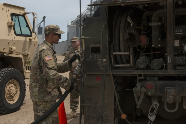 Soldiers with Alpha Company, 334th Brigade Support Battalion, 2nd Infantry Brigade Combat Team, Iowa Army National Guard (IANG) based in Cedar Rapids, Iowa, fuel vehicles at a refueling point at the United Farmers Cooperative in Winthrop, Minn., on July 13, 2019.  More than 3,800 Iowa and Minnesota National Guard Soldiers traveled to Camp Ripley to participate in an eXportable Combat Training Capability (XCTC) exercise designed to train brigade combat teams down to the platoon level.