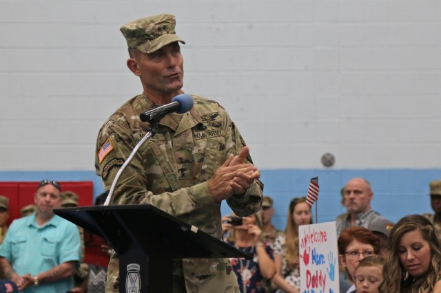 Maj. Gen. Brian Mennes, 10th Mountain Division commander, applauds spouses and Families of 2nd Brigade Combat Team Soldiers for their support during the Commando brigade's second Welcome Home ceremony following a nine month deployment, July 15, 2019, at Fort Drum, New York, Last fall around 2,000 Soldiers from 2BCT deployed to Kosovo and Afghanistan in support of an ongoing North Atlantic Treaty Organization peacekeeping mission and Operation Resolute Support. (U.S. Army photo by Staff Sgt. Paige Behringer)