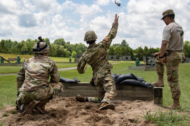 Cadet Samuel Gordon, from Indiana University, throws a dummy grenade towards the target during the hand grenade qualification course at Fort Knox, July 5, 2019.
