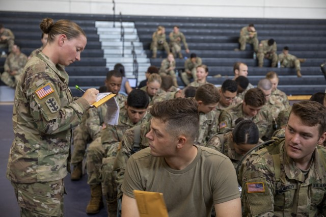 Sgt. 1st Class Kerrilee Case signs as a witness on a cadet's bone marrow donor registration form during the American Red Cross's Cadet Summer Training Blood Drive held July 12, 2019 at Smith Fitness Center on Fort Knox, Ky. (U.S. Army photo by Wendy Arevalo)