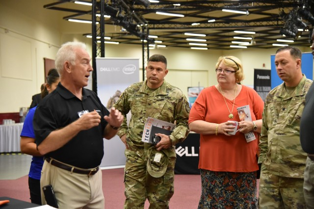 U.S. Army Garrison Rheinland-Pfalz Commander, COL Jason T. Edwards, listens to a briefer at one of the Tech Expo exhibits last year.