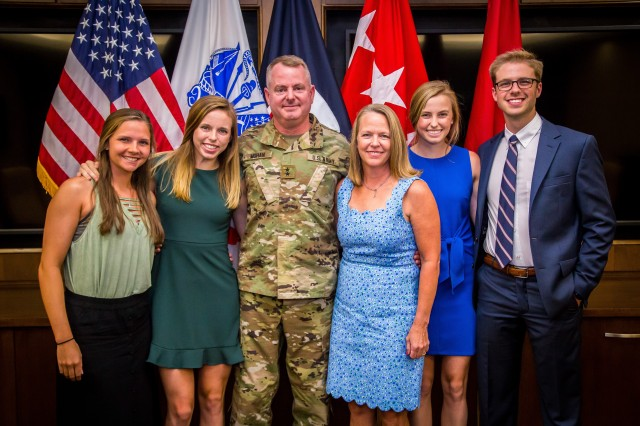Maj. Gen. Chris Mohan celebrates his promotion to two-star general with his family. Mohan was promoted during a ceremony at Army Materiel Command Headquarters, Redstone Arsenal, Ala., July 11.