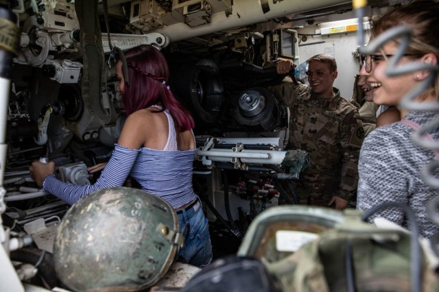 "Local residents enjoy operating the turret in an M109 Palidin during the ""Tank Battle"" event held at Below Piskie Training Area, July 13."