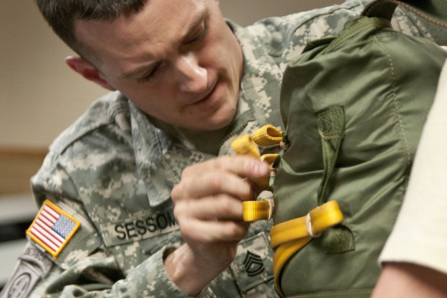 Sgt. 1st Class Kyle Sessoms, the assistant operations non-commissioned officer in-charge for Headquarters and Headquarters Troop, 1st Squadron, 73rd Cavalry Regiment, 2nd Brigade Combat Team, inspects a paratrooper's equipment, April 17, during the jumpmaster personnel inspection event of the 82nd Airborne Division's Jumpmaster of the Year competition. Sessoms, a Belleville, Mich. native, won the competition, held April 16-25, at Fort Bragg, N.C.