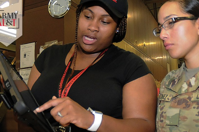Shai'mel Bell, warehouse specialist, shows Pvt. Jeanneth Martinez and Spc. Lorimay Melendez how to use a training version of the Global Combat Support System -- Army. The web-based logistics tracking and transaction system was designed to be used throughout the Army, but training gaps have hindered its effectiveness. (Photo by Terrance Bell, U.S. Army Garrison Fort Lee Public Affairs)