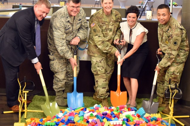 Dignitaries from Joint Base Lewis-McChord and the Children's Museum of Tacoma take part in a modified ground breaking ceremony of the new satellite Children's Museum of Tacoma inside the vacant JBLM skating rink building Wednesday, Nov. 14, 2018. From left to right: Brain Marlow, Children's Museum of Tacoma's board president; Col. William Percival, JBLM Garrison deputy commander; Col. Nicole Lucas, JBLM Garrison commander; Tanya Durand, Tacoma Children's Museum; and Command Sgt. Maj. Walter Tagalicud, I Corps command sergeant major.