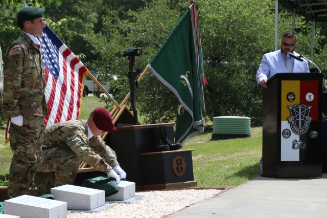 The last of the memorial stones is revealed during the 3rd Special Forces Group (Airborne) memorial stone laying ceremony, May 22, 2018 at Fort Bragg N.C. Seven new stones were added to the 3rd SFG (A) memorial walk in remembrance of the recently fallen 3rd SFG (A) Soldiers. (U.S. Army photo by Sgt. Steven Lewis)