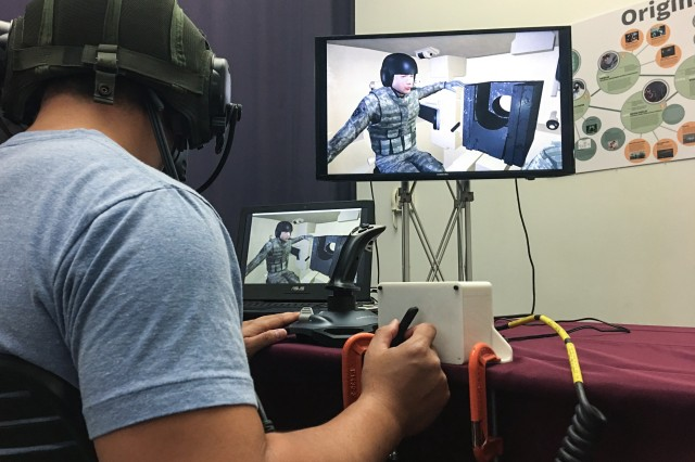 Institute for Creative Technology staff members conduct testing of the Team Assessment and Learner Knowledge Observational Network, or TALK-ON. The program was developed to help train tank commanders and test the cognitive aspect of a commander's decision making process.