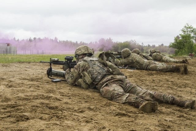 Soldiers from Company A, 1st Battalion, 32nd Infantry Regiment conduct marksmanship training during a live fire exercise, July 12, on Fort Drum, N.Y. (U.S. Army photo by Pfc. Tiffany Banks.)
