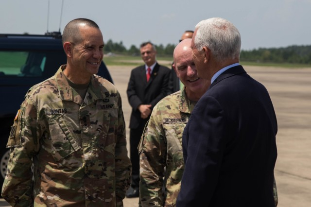 Vice President Mike Pence converses with Lieutenant General Leopoldo Quintas Jr., deputy commanding general, U.S. Army Forces Command, and Major General Brian McKiernan, deputy commanding general, XVIII Airborne Corps and Fort Bragg, at Pope Army Airfield on Fort Bragg, N.C. July 17, 2019. Pence was visiting Fort Bragg to speak at a Salute to the Troops ceremony. (U.S. Army Photo by Pfc. Joshua Cowden / 22nd Mobile Public Affairs Detachment)