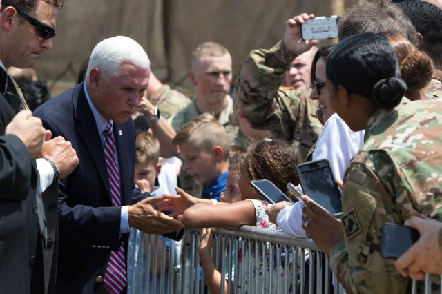 Vice President Mike Pence greets and shakes hands with a crowd of military personnel after arriving at Pope Army Airfield at Fort Bragg, N.C. July 17, 2019. Pence was visiting Fort Bragg to speak at a Salute to the Troops ceremony. (U.S. Army Photo by Pfc. Joshua Cowden / 22nd Mobile Public Affairs Detachment)