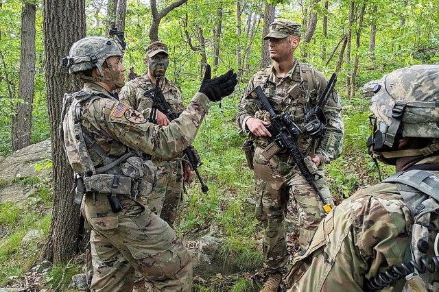 Members of Combat Advisor Teams 1121 and 1122 advise cadets on Introduction to Patrolling during the Cadet Field Training field training exercise at West Point. The CATs are from 1st Security Force Assistance Brigade, Fort Benning, Ga., and are the first SFAB to volunteer to integrate into Cadet Summer Training at the academy.