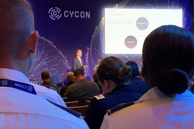 """Cadets listen to a presentation on """"Demystifying Blockchain: Practical Use-Cases of KSI Technology"""" during the International Conference on Cyber Conflict (CyCon) in Tallinn, Estonia, as part of their cyber-focused AIAD."""