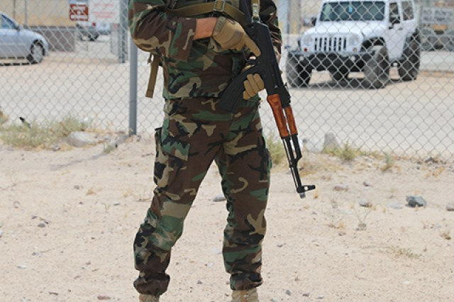 A Moldovan soldier provides security during Operation Hickory Sting at Fort Irwin, Calif., July 3, 2019. Operation Hickory Sting is a decisive action rotation focused on combined arms maneuver and collective gunnery at the National Training Center, Fort Irwin, Calif., in order to validate the capabilities of the 30th Armored Brigade Combat Team in the training environment and provide a globally responsive brigade ready to deploy, fight and win.
