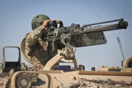 A West Virginia National Guardsman assigned to 150th Cavalry Regiment, 30th Armored Brigade Combat Team pulls security on a 113 Armored Personnel Carrier during Operation Hickory Sting at Fort Irwin, Calif., July 8, 2019. Operation Hickory Sting is a...