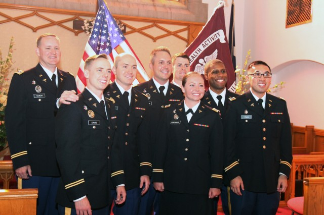Eight dentists graduated from the Fort Sill 2019 Comanche Advanced Education in General Dentistry - 12 Month program July 10, 2019, at the New Post Chapel. The graduates are from left, Captains Kyle Leach, Dustin Davis, Benjamin Ottoson, Preston Melhauser, Matthew Firestone, Jessica Sencindiver, Charles Lewis, and Kevin Tran. They will now work at Army dental clinics worldwide.