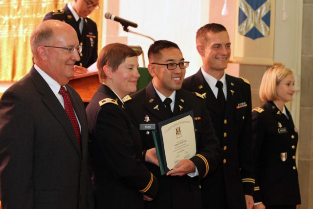 Capt. Kevin Tran (third from left) holds his diploma and shakes hands with Col. Ann Behrends, Fort Sill Dental Activity commander and dean of the Comanche AEGD program. All the graduates also received Army Achievement Medals. Also participating were retired Army dentist Col. Dr. Art Scott; Maj. Michael Kroll, AEGD program director; and Maj. Jillian Seglem, AEGD assistant program director. Tran will be stationed in Korea.