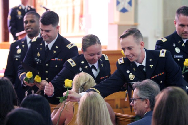 During the AEGD-12 graduation the graduates handed yellow roses to their families and friends July 10, 2019, at the New Post Chapel.