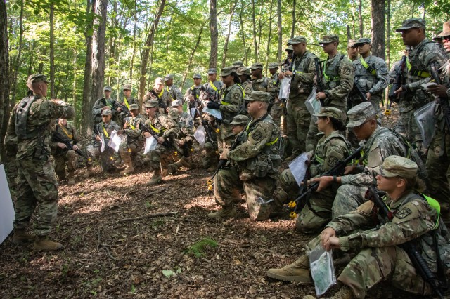3rd Regiment, Basic Camp Cadets listens as Staff Sgt. William Benson explains the different major terrain features the Cadets will encounter during land navigation at Fort Knox, July 13, 2019. Cadets will use this information to complete their day and night land navigation later during basic camp