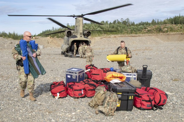 Mississippi Army National Guard Maj. Richmond Lachney and Staff Sgt. Vernon Wasson, 47th Weapons of Mass Destruction-Civil Support Team, unload equipment from an Alaska Army National Guard CH-47 Chinook helicopter during ORCA 2019 in Alaska, July 16. ORCA is a chemical, biological, radioactive, nuclear threats response exercise designed for participants to provide support in the aftermath of hazardous materials incidents. ORCA tests interoperability between agencies increases opportunities for working relationships and practices requests for assistance methods. 120 National Guardsmen from CST units in Alaska, Mississippi, Montana, Utah, Nevada, Hawaii and Washington are in Alaska to participate in Exercise ORCA 2019. 1st Battalion, 207th Aviation aircrews from the Alaska unit transported CST members to several exercise locations in support of event scenarios.