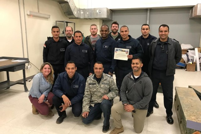 The U.S. Army Redstone Test Center Modernized HELLFIRE Universal Test Set team, including Brian Rivers, Danielle Finch, Jacob Saltich and Jeremiah Clark are pictured here with members of the Egyptian Air Force.