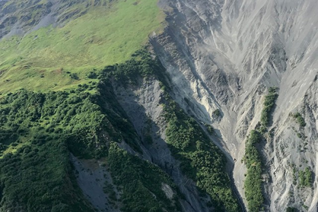 Mount Marathon, the mountain hikers, were on, indicating the rugged, steep terrain where they found themselves off-trail and unable to return safely.