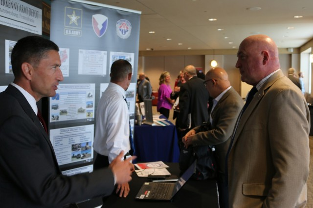 Industry attendees visit booths featuring information about business opportunities during Team Redstone's 2019 Center of Excellence - Advance Planning Briefings to Industry, July 17 and 18. The theme for this year's APBI was Building Supply Chain Depth through Strategic Partnerships and Increased Industrial Capacity.