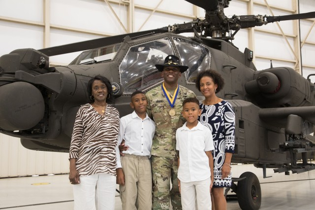 U.S. Army Redstone Test Command's Aviation Flight Test Directorate Commander Lt. Col. Cornelius L. Allen, Jr., pictured with this family, relinquishes command of Aviation Flight Test Directorate to head to Senior Service College at Air War College at Maxwell Air Force Base in Montgomery.