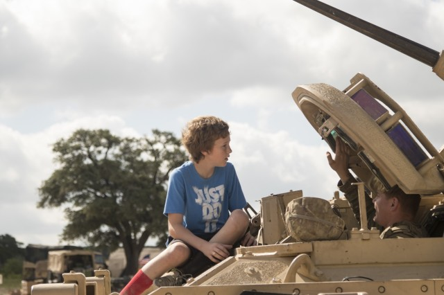 Spc. Connor Loftin, 1st Squadron, 7th U.S. Cavalry Regiment, gives a brief on how to operate a Bradley Fighting Vehicle at the Garryowen Family Day on July 17, 2019, Fort Hood, Tx. Families of Soldiers and veterans were given the opportunity to see how Soldiers operated in a tactical environment at the event. (U.S. Army photo by Pfc. Alisha Edwards, 7th Mobile Public Affairs Detachment)