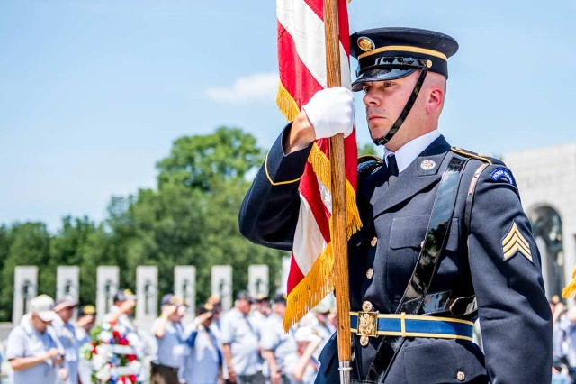 A Soldier with the 3rd U.S. Infantry Regiment (The Old Guard) participates in a Joint Armed Forces Color Guard in support of Honor Flight Chicago at the World War II Memorial, Washington, D.C., July 10, 2019. An Honor Flight is conducted by non-profit organizations dedicated to transporting as many United States military veterans as possible to see the memorials in D.C. of the respective war they fought in at no cost to the veterans. During the event, Colin Powell, retired four-star Army general and former United States Secretary of State, spoke to more than 100 veterans, sharing his appreciation for their service.