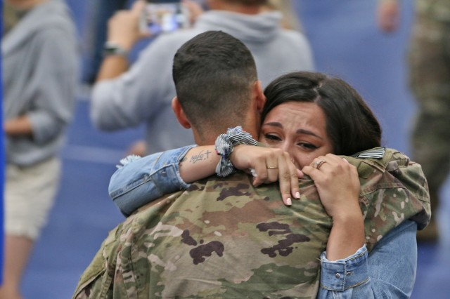 Friends and family greeted around 100 more Soldiers of 2nd Brigade Combat Team, 10th Mountain Division during a Welcome Home ceremony following a nine month deployment, July 19, 2019, at Fort Drum, New York. Last fall around 2,000 Soldiers from 2BCT deployed to Kosovo and Afghanistan in support of an ongoing North Atlantic Treaty Organization peacekeeping mission and Operation Resolute Support. (U.S. Army photo by Staff Sgt. Paige Behringer)