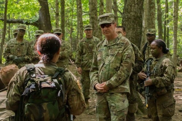 Cadet Nicola Patel (left), 7th Regiment, Advanced Camp and a student at the University of Massachusetts,  speaks with Gen. James C. McConville (right), the 36th Vice Chief of Staff of the Army, during her field training exercise (FTX) after conducting a platoon assault at Fort Knox, Ky., July 17, 2019.