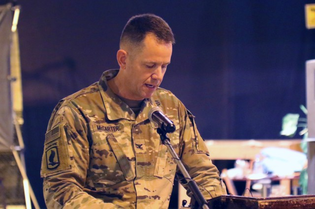 Col. Jeffrey McCarter, 8th Medical Brigade commander, speaks during a transfer of authority ceremony between 8th Medical Brigade and 3rd Medical Command Deployment Support - Forward at Camp As Sayliyah, Qatar. (U.S. Army National Guard photo by Sgt. Connie Jones)