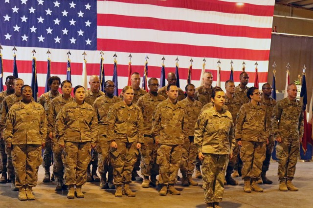 Soldiers of 8th Medical Brigade stand in formation during a transfer of authority ceremony between 8th Med and 3rd Medical Command Deployment Support - Forward at Camp As Sayliyah, Qatar, July 18, 2019. (U.S. Army National Guard photo by Sgt. Connie Jones)