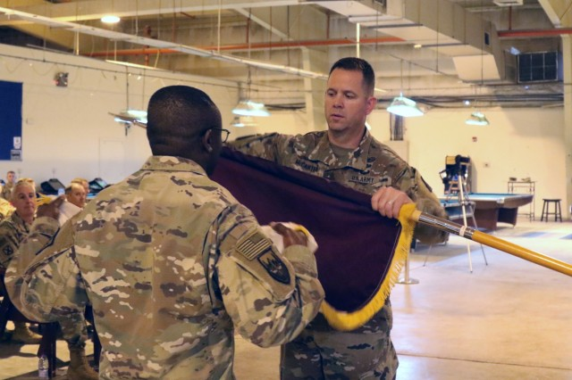 Col. Jeffrey McCarter, 8th Medical Brigade commander, cases the colors with Command Sgt. Maj. Ekondua Amoke during a transfer of authority ceremony with the 3d Medical Command Deployment Support -  Forward at Camp As Sayliyah, Qatar, July 18, 2019. (U.S. Army National Guard photo by Sgt. Connie Jones)