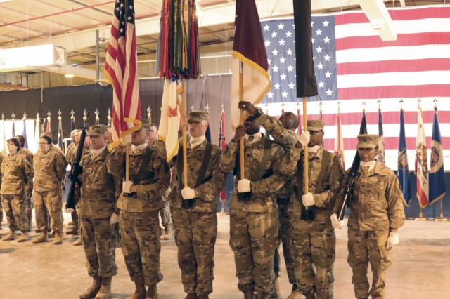 Command Sgt. Maj. Bernard Small, 1st Theater Sustainment, assists the unit color guard before a transfer of authority ceremony between 8th Medical Brigade and 3d Medical Command Deployment Support - Forward at Camp As Sayliyah, Qatar, July 18, 2019. (U.S. Army National Guard photo by Sgt. Connie Jones)