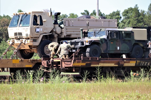 Military vehicles and equipment belonging to the 1158th Transportation Company and the 107th Surface Maintenance Company of the Wisconsin National Guard are loaded on railcars July 11, 2019, at Fort McCoy, Wis. The equipment was being shipped to Fort Hood, Texas, to be a part of a large exercise later in the year. The rail loading and related work was completed by 1158th and 107th Soldiers, 829th Engineer Company Soldiers, and employees with the Fort McCoy Logistics Readiness Center Transportation Division. (U.S. Army Photo by Scott T. Sturkol, Public Affairs Office, Fort McCoy, Wis.)