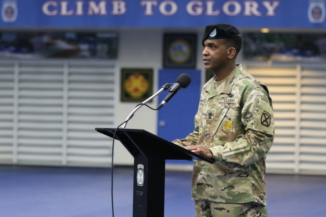 Command Sgt. Maj. Mike Bostic, the former senior enlisted advisor for the 10th Headquarters Special Troops Battalion gives his final speech during the Relinquishment of Responsibility ceremony at Magrath Sports Complex July 18, 2019, on Fort Drum, NY.