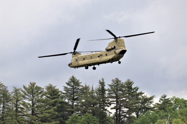 An aircrew with the 2nd Battalion, 238th General Support Aviation Battalion of the Illinois National Guard flies a CH-47 Chinook helicopter on a mission June 12, 2019, from the cantonment area at Fort McCoy, Wis. Two Chinook helicopters from the battalion were completing heavy helicopter operations in support of the 1st Battalion, 106th Assault Helicopter Battalion annual training at the installation in early June 2019. According to unit officials, unit Soldiers exercised company-level mission-essential tasks, such as conducting air movement and expeditionary deployment operations as well as forward armor and refueling point procedures. (U.S. Army Photo by Scott T. Sturkol, Public Affairs Office, Fort McCoy, Wis.)